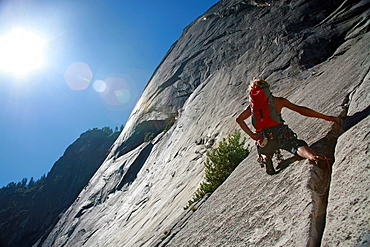 Rock climber in action in Yosemite Valley, California, United States of America, North America