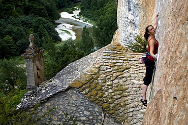A climber on the cliffs known as the Tennessee Walls, high above the Tarn river and home to some of the most spectacular pitches of rock climbing in Europe, Gorges du Tarn, near Millau and Rodez, Cevennes region, south west France, Europe