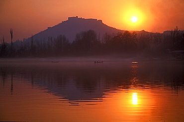 Fishermen make their way home in canoes as the sun sets over Nigeen Lake, Srinagar, capital of Indian-administered Kashmir, India, Asia