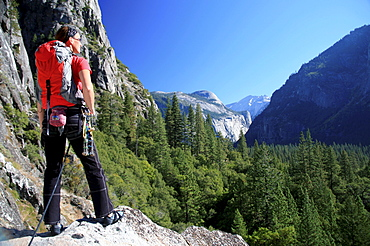 A climber takes a break on the lower slopes of El Capitan to enjoy the view up the Yosemite Valley towards Washington Column and North Dome, Yosemite National Park, UNESCO World Heritage Site, California, United States of America, North America