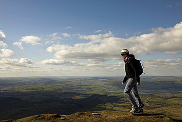 A hiker walks north from Hay Bluff, above Hay-on-Wye, Brecon Beacons National Park, Herefordshire, England, United Kingdom