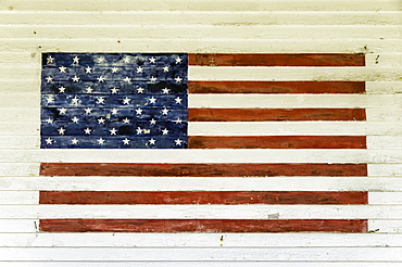 US Flag painted on the side of a wooden building in the historic area of Chatham, Massachusetts, New England, United States of America, North America