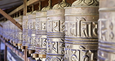 Prayer wheels at the Buddhist monastery in Tengboche in the Khumbu region of Nepal, Asia
