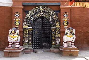 Lion statues outside a gate at the Taleju Temple, Durbar Square, Kathmandu, Nepal, Asia
