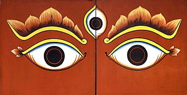 Buddha eyes painted on a door in Kathmandu, Nepal, Asia