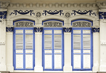 Close-up of traditional old houses with shuttered windows and decorative mouldings in Little India, Singapore, Southeast Asia, Asia