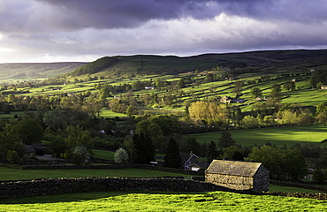 View down the valley of Swaledale taken from just outside Reeth, Yorkshire Dales, Yorkshire, England, United Kingdom, Europe