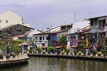 Colourful murals on houses along the Melaka River in Melaka (Malacca), Malaysia, Southeast Asia, Asia