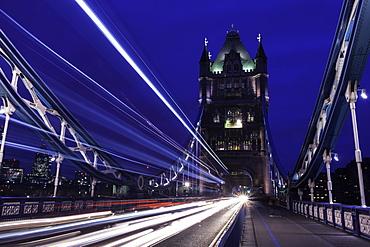 Light trails on London bridge in the evening, London, United Kingdom, Europe