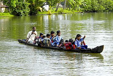 School children in a local boat, Alleppey, Kerala, India, Asia