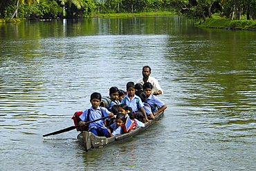 School children in a country boat, Alleppey, Kerala, India, Asia