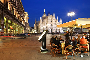 Restaurant in Piazza Duomo at dusk, Milan, Lombardy, Italy, Europe