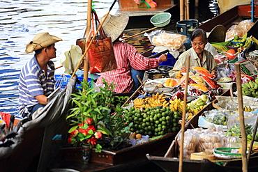 Thai woman selling fruit at floating market, Bangkok, Thailand, Southeast Asia, Asia