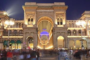 Galleria Vittorio Emanuele entrance illuminated at dusk, Milan, Lombardy, Italy, Europe