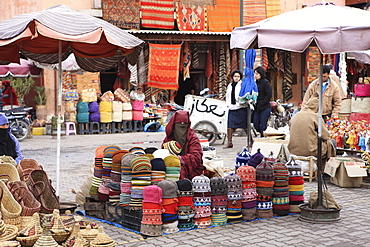 Market trader on hat stall, Marrakech, Morocco, North Africa, Africa