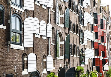Old canal warehouses converted to houses, Amsterdam, Netherlands, Europe