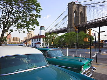 Two 1950's cars parked near the Brooklyn Bridge at Fulton Ferry Landing, Brooklyn, New York City, New York, United States of America, North America
