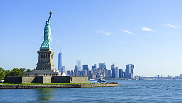 Statue of Liberty and Liberty Island with Manhattan skyline in view, New York City, New York, United States of America, North America