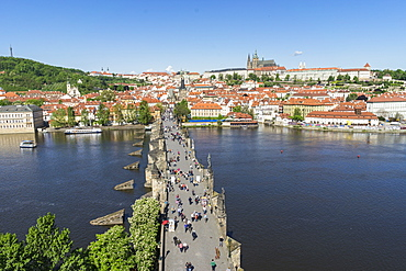 High angle view of Charles Bridge looking towards the Castle District, Royal Palace and St. Vitus's Cathedral, UNESCO World Heritage Site, Prague, Czech Republic, Europe