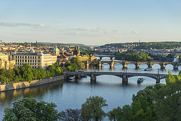 Cityscape looking down the Vltava River at the bridges connecting the Old Town to Mala Strana, Prague Castle and Hradcany, Prague, Czech Republic, Europe