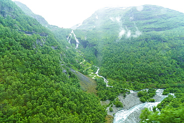 A view of waterfalls and forest from the Flam Railway, Flamsbana, Flam, Norway, Scandinavia, Europe