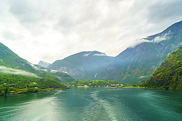 The small town of Flam situated at the innermost part of Aurlandsfjord, a branch of Sognefjord, a popular tourist destination as the Flam Railway, Flamsbana, departs from here, Flam, Norway, Scandinavia, Europe