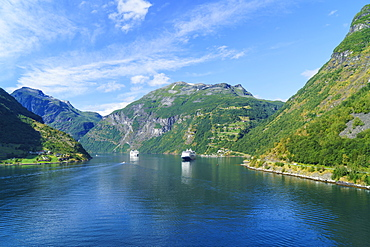 Cruiseships moored at the head of Geirangerfjord by the village of Geiranger, UNESCO World Heritage Site, Norway, Scandinavia, Europe