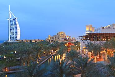 Burj Al Arab viewed from the Madinat Jumeirah Hotel at dusk, Jumeirah Beach, Dubai, United Arab Emirates, Middle East