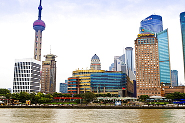 Pudong skyline across the Huangpu River, Oriental Pearl tower on left, Shanghai, China, Asia
