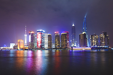 Pudong skyline at night across the Huangpu River, Shanghai, China, Asia