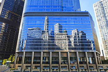 Skyscrapers on West Wacker Drive reflected in the Trump Tower, Chicago, Illinois, United States of America, North America
