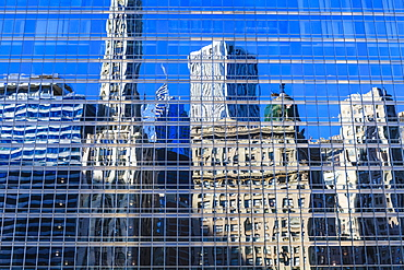 Buildings on West Wacker Drive reflected in the Trump Tower, Chicago, Illinois, United States of America, North America