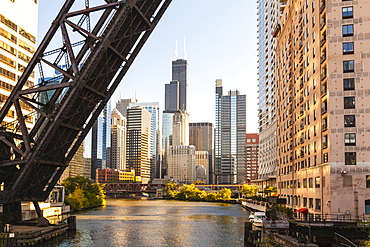 Chicago River and towers of the West Loop area,Willis Tower, formerly the Sears Tower in the background, a raised disused railway bridge in the foreground, Chicago, Illinois, United States of America, North America