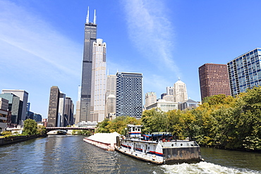 River traffic on the south branch of the Chicago River, Willis Tower, formerly the Sears Tower dominates the skyline, Chicago, Illinois, United States of America, North America