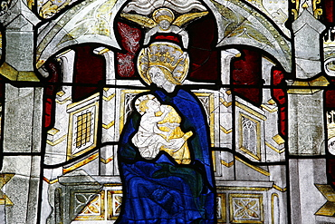 Stained glass window of the Virgin and Child at Collegiale Notre-Dame des Marais, Villefranche-sur-Saone, Rhones-Alpes, France, Europe