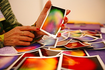 Fortuneteller showing a picture of an aura, Paris, France, Europe