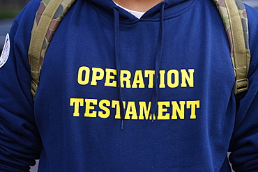 Operation Testament lettering on Catholic t-shirt, Sydney, New South Wales, Australia, Pacific