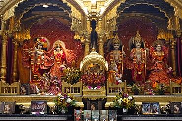 From left to right, statues of Krishna, Rada, Rama, with Hanuman in front, Sita and Laxmi, Bhaktivedanta Manor temple, Watford, Hertfordshire, England, United Kingdom, Europe