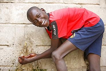 Boy washing hands, Dakar, Senegal, West Africa, Africa