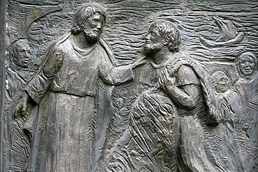 Sculpture of the calling of St. Peter on the Notre Dame door, Saint-Pierre de Montmartre church, Paris, France, Europe