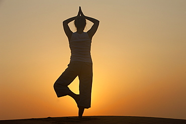 Sunset meditation in the desert, Abu Dhabi, United Arab Emirates, Middle East