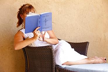 Woman reading the Bible, Abu Dhabi, United Arab Emirates, Middle East