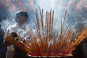 Burning incense during Tet, the Vietnamese lunar New Year celebration, Quan Am Pagoda, Ho Chi Minh City, Vietnam, Indochina, Southeast Asia, Asia