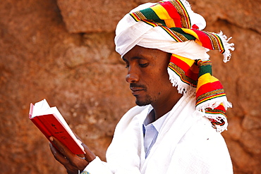 Faithful reading outside a church in Lalibela, Ethiopia, Africa