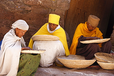 Nuns sorting wheat in Bet Maryam church courtyard, Lalibela, Wollo, Ethiopia, Africa