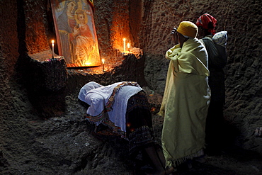 Women praying in Bet Medhane Alem church in Lalibela, Wollo, Ethiopia, Africa