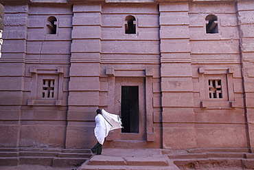 Faithful entering a Lalibela church, Ethiopia, Africa