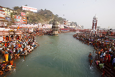 Thousands of devotees converge to take a dip in the River Ganges at Navsamvatsar, a Hindu holiday during the Maha Kumbh Mela festival, Haridwar, Uttarakhand, India, Asia