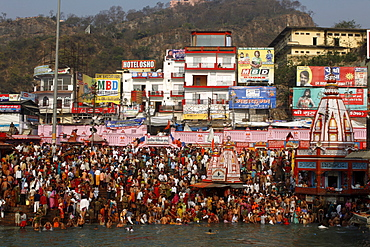 Thousands of devotees converge in Haridwar to take a dip in the river Ganges on the occasion of Navsamvatsar, a Hindu holiday taking place during the Maha Kumbh Mela festival, Haridwar, Uttarakhand, India, Asia