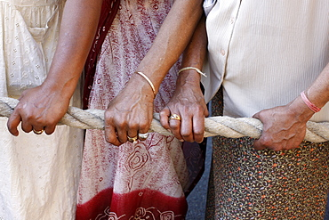 Devotees pulling the rope of the giant chariot carrying Lord Krishna, Ratha Yatra Chariot festival, Paris, France, Europe